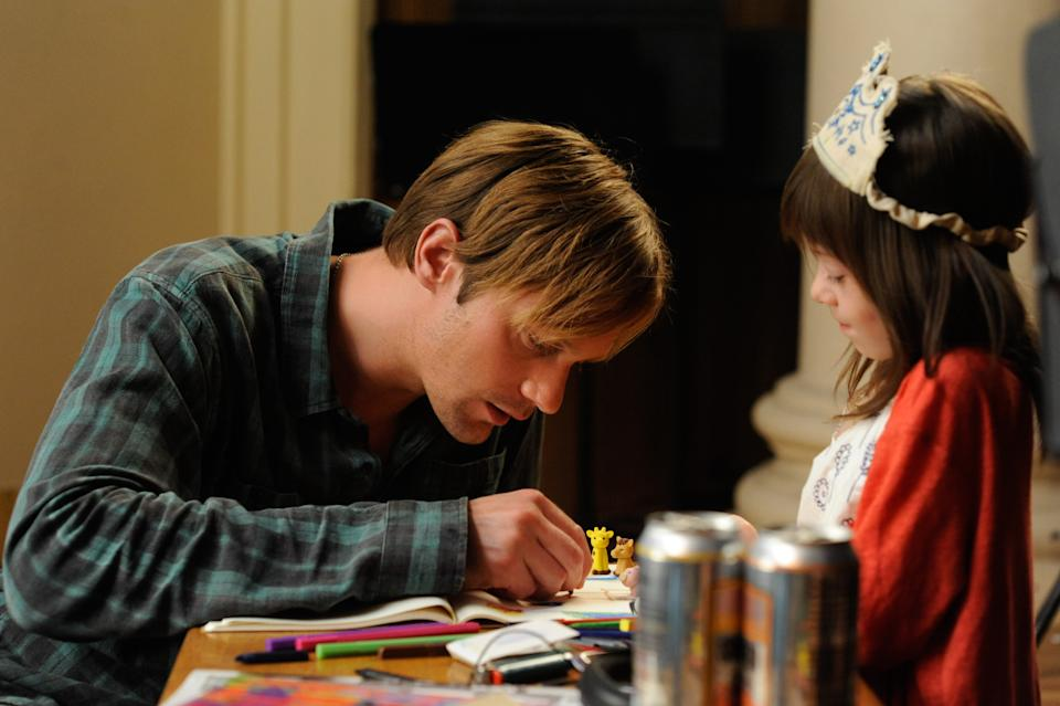 "This film image released by Millennium Entertainment shows Onata Aprile, right, and Alexander Skarsgard in a scene from ""What Maisie Knew.""  (AP Photo/Millennium Entertainment, JoJo Whilden)"