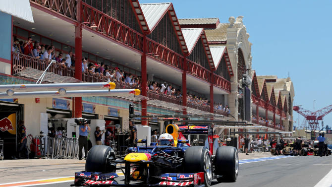 Red Bull Racing Formula One driver Sebastian Vettel steers his racing car in the pit lane during a qualifying session at the Valencia street circuit, in Valencia, Spain, Saturday June 23, 2012. The 2012 Formula One Grand Prix of Europe will take place on 24 June. (AP Photo/Valdrin Xhemaj, Pool)