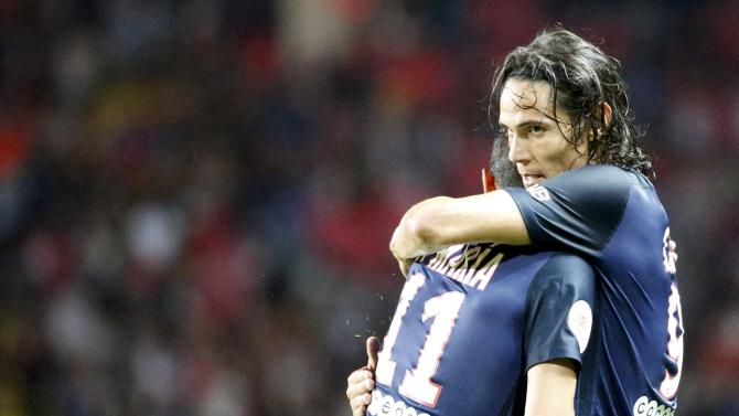 Paris St Germain's Cavani celebrates with team mate Di Maria after scoring the first goal for the team during their Ligue 1 soccer match against Monaco at Louis II stadium in Monaco