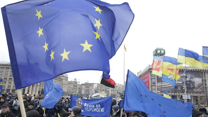 Demonstrators wave European flags during a protest in support of Ukraine's integration with the European Union in the center of Kiev, Ukraine, Thursday Nov. 28, 2013. As leaders of the European Union gather for a summit to discuss the bloc's eastern expansion, both EU and Ukrainian officials said Thursday that the suspension of talks on closer ties could still be revived after the two-day meeting. (AP Photo/Sergei Chuzavkov)