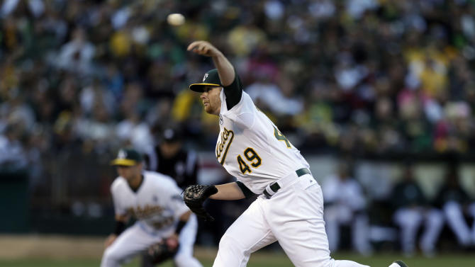 Oakland Athletics' Brett Anderson works against the Seattle Mariners in the first inning of a baseball game Monday, April 1, 2013, in Oakland, Calif. (AP Photo/Ben Margot)