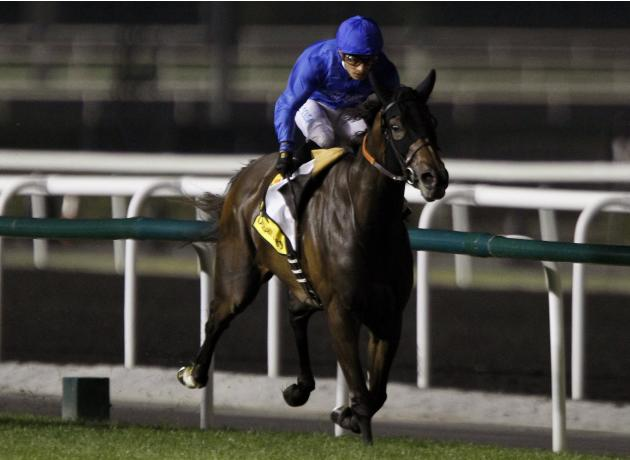 "De Sousa, riding Sajjhaa of Britain, races towards the finish line during the seventh race ""Dubai Duty Free"" of the Dubai World Cup at the Meydan Racecourse in Dubai"