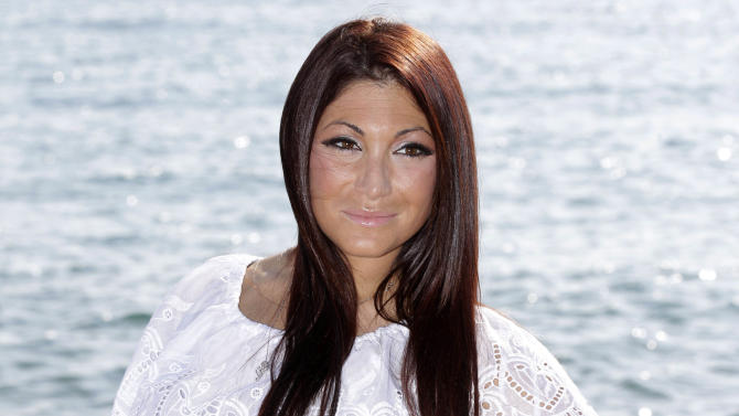 """FILE - This April 1, 2012 file photo shows Deena Nicole Cortese, a cast member on the MTV reality series """"Jersey Shore""""  posing for photographers during the MIPTV, International Television Programme Market, in Cannes, southern France. Seaside Heights New Jersey Police Chief Tommy Boyd tells WNBC TV in New York that Deena Cortese was arrested Sunday, June 10, on a disorderly conduct charge. Boyd says a borough officer saw Cortese """"a little intoxicated"""" and standing in the middle of a street, slapping cars that were driving by. Boyd says Cortese was taken to police headquarters and later released on a summons. (AP Photo/Lionel Cironneau, file)"""