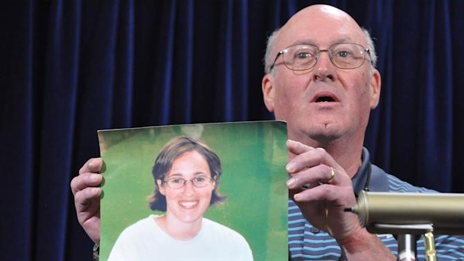 Martin Toyen, of Avon, Connecticut, holds a photograph of his late daughter Amy during a press conference at the end of pre-trial hearings for the five Guantanamo prisoners accused of orchestrating the Sept. 11, 2001 terrorist attacks, inside the Camp Justice compound on the Guantanamo Bay U.S. Naval Base in Cuba, Friday, Oct. 19, 2012. Amy died at age 24 in the World Trade Center attack. The five defendants face charges that include terrorism and murder for allegedly planning and helping to carry out the Sept. 11, 2001 hijacking plot. They could get the death penalty if convicted. (AP Photo/Toronto Star, Michelle Shephard, Pool)