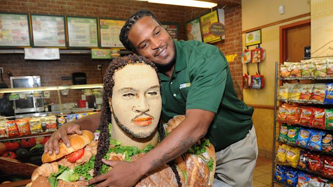 """IMAGE DISTRIBUTED FOR SUBWAY -Linebacker Jarvis Jones, 2013 draft prospect and newest Famous Fan of SUBWAY, unveils a life-size """"Smokehouse BBQ Chicken"""" sculpture to announce his official SUBWAY Famous Fan title, Tuesday, April 23, 2013, in New York.  The sculpture is an artistic representation of the football star from the chest up, standing approximately three feet tall and made of almost entirely SUBWAY Smokehouse BBQ Chicken.  Jarvis joins a roster of fellow Famous Fans that include Robert Griffin III, Justin Tuck, Michael Strahan, Blake Griffin and Michael Phelps.† (Photo by Diane Bondareff/Invision for SUBWAY/AP Images)"""