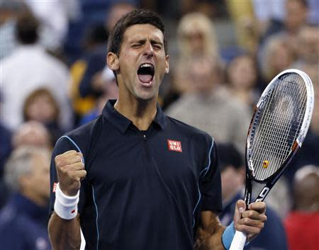 Djokovic of Serbia celebrates defeating Youzhny of Russia during quarter-final match at U.S. Open tennis championships in New York