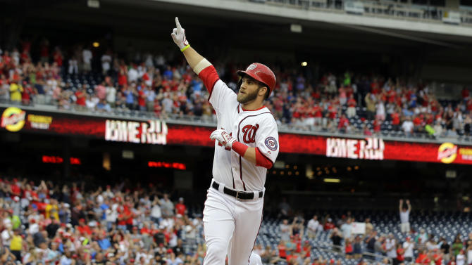 Washington Nationals' Bryce Harper celebrates as he crosses home for his solo home run during the first inning of a baseball game against the Milwaukee Brewers at Nationals Park Monday, July 1, 2013, in Washington. This is Harper's first game back after being on the disabled list. (AP Photo/Alex Brandon)