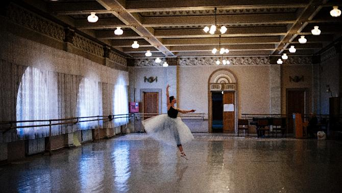 A ballerina practices at the Donetsk State Academic Opera and Ballet Theatre