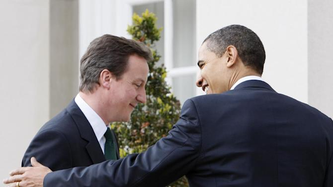 FILE - In this April 1, 2009, file photo President Barack Obama meets with then-leader of Britain's conservative party, David Cameron, at Winfield House in London. Monday, May 13, 2013, Obama welcomes now British Prime Minister Cameron to the White House for talks on subjects ranging from Syria's civil war to preparations for the June 17-19 summit of the world's leading industrial nations in Northern Ireland. Before joining the summit, Obama is scheduled to stop in Belfast, his first visit to Northern Ireland. (AP Photo/Charles Dharapak, File)