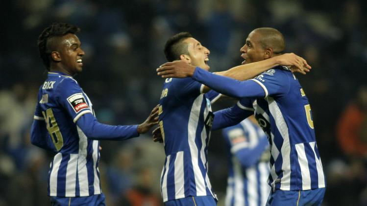 Porto's Herrera celebrates his goal against Olhanense with his teammates Fernando and Kelvin during their Portuguese Premier League soccer match at Dragao stadium in Porto