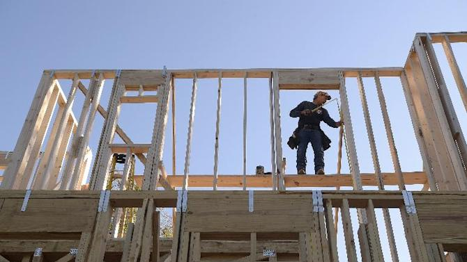 Construction worker David Rager, 53, frames a window in the upper floor of a two-story custom home being built in Orlando, Fla., Friday, Feb. 13, 2015. As construction jobs return in some regions, competition for skilled labor is heating up.(AP Photo/Phelan M. Ebenhack)