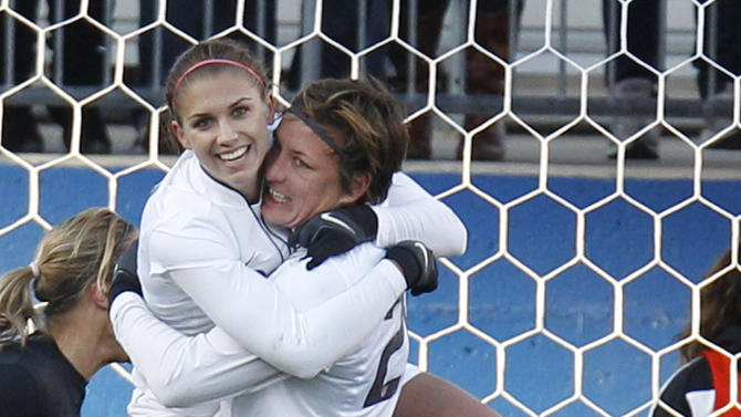 United States' Alex Morgan, left, and Abby Wombach (20) celebrate Morgan's first goal against New Zealand during the second half of an international friendly soccer match in Frisco, Texas, Saturday, Feb. 11, 2012.  The U.S. won  2-1.  (AP Photo/LM Otero)