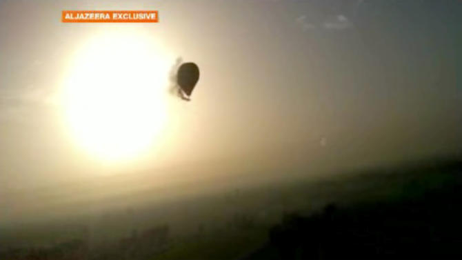 In this image taken from amateur video provided by Al-Jazeera, smoke pours from a hot air balloon over Luxor, Egypt, before bursting and plummeting about 1,000 feet to earth on Tuesday, Feb. 26, 2013. Nineteen people were killed in what appeared to be the deadliest hot air ballooning accident on record. A British tourist and the Egyptian pilot, who was badly burned, were the sole survivors. (AP Photo/Al-Jazeera) MANDATORY CREDIT: AL-JAZEERA