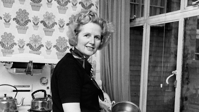 """FILE -  Feb, 1, 1975  file photo of the them Conservative Member of Parliament  Margaret Thatcher, in her Chelsea home kitchen. She was Britain's first female leader, a strong woman who battled her way to the top of a male-dominated political system _ but don't call Margaret Thatcher a feminist. The former prime minister, who died Monday aged 87, rejected the label _ """"I owe nothing to women's lib,"""" she once said _ and she leaves a contested legacy for women. (AP Photo/ PA/File) UNITED KINGDOM OUT"""