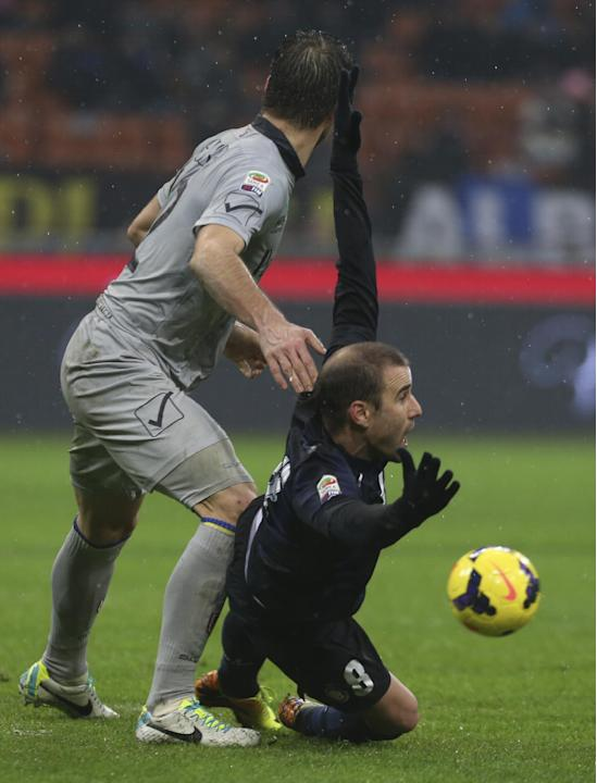 Inter Milan forward Rodrigo Palacio, of Argentina, falls during a Serie A soccer match between Inter Milan and Chievo Verona, at the San Siro stadium in Milan, Italy, Monday, Jan. 13, 2014. The match