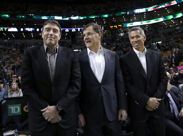 In this photo taken on Dec. 18, 2013, Boston Celtics managing partner Wyc Grousbeck, left, stands with venture capitalist Bob Higgins, center, and team co-owner Mark Wan, right, during a break in the