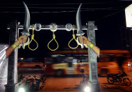 In this Monday Oct.10, 2011 photo, symbolic nooses are seen at the relay hunger protest place, where people from different Tamil organization sit daily to protest against death penalty of the three convicted in the 1991 assassination of former Indian Prime Minister Rajiv Gandhi, in Chennai, India. Across most of India the three men on death row in the Gandhi assassination are reviled as murderous traitors to the nation. But many Tamils, a major ethnic group in southern India, see things very differently. (AP Photo/Nathan G.)