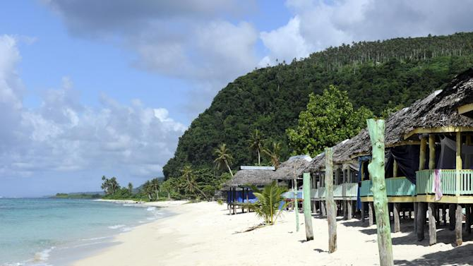 Huts on a beach are seen in Samoa, in February 2014