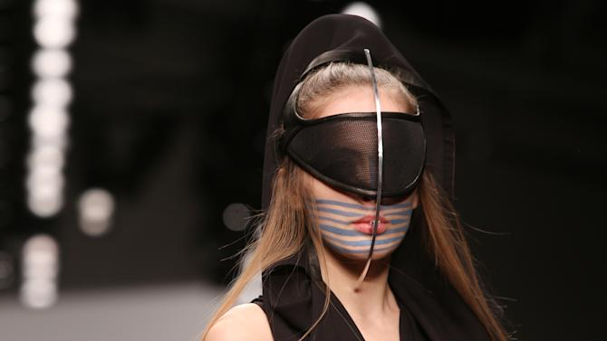 A model wears a design created by Haizhen Wang during London Fashion Week, at Somerset House in central London, Tuesday, Feb. 19, 2013. (Photo by Joel Ryan/Invision/AP)