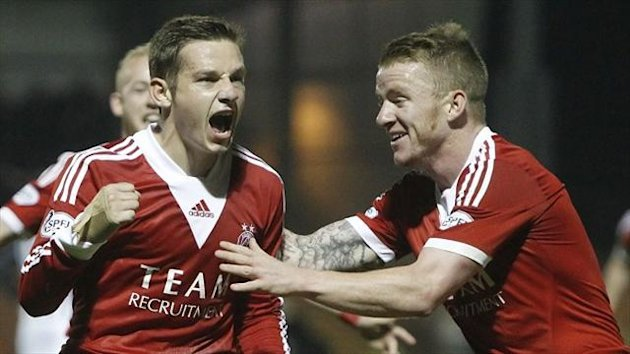 Peter Pawlett, left, salvaged a late draw for Aberdeen