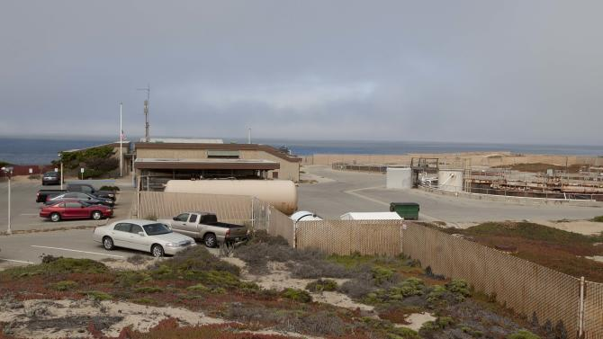 In this photo taken Thursday, Sept. 13, 2012, in the left foreground is the exterior of a shut down desalination plant in Marina, Calif., with Monterey Bay in the background. Not long ago, the idea of squeezing salt from the ocean to make clean drinking water was embraced warmly in thirsty California with its cycles of drought and growing population. But it has not panned out the way many hoped. Desalination plants are costing more to build; they're huge energy suckers and lingering concerns about the impact to marine life have spurred myriad lawsuits. (AP Photo/Eric Risberg)