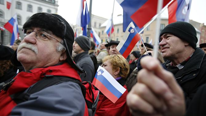 Thousands rally for, and against, Slovenia's gov't