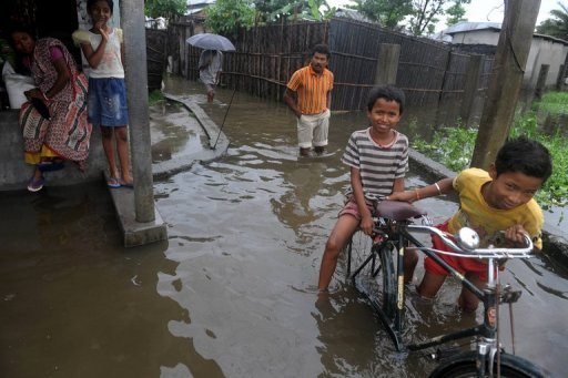 <p>Residents wade through waterlogged roads in Dhantola village on the outskirts of Siliguri. The death toll from heavy monsoon rains which have caused massive flooding in India's northeast has risen to more than 120, with six million forced to flee their homes, officials said Saturday.</p>