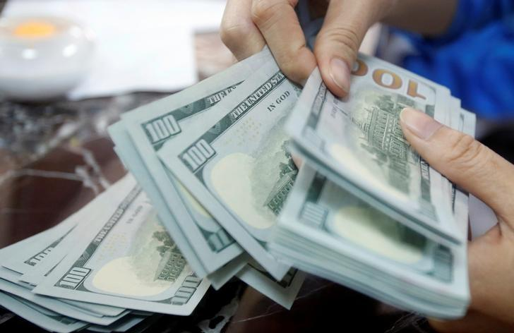 Dollar hits eight-month high; global stocks post weekly gain
