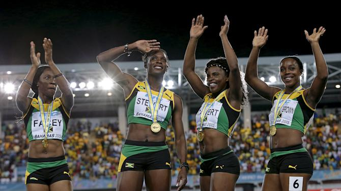 Jamaica's 4x4100 relay team celebrate with their gold medals on the podium after winning the event at the IAAF World Relays Championships in Nassau