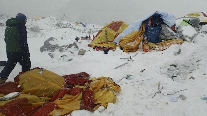 In this photo provided by Azim Afif a man approaches the scene after an avalanche triggered by a massive earthquake swept across Everest Base Camp, Nepal on Saturday, April 25, 2015. Afif and his team of four others from the Universiti Teknologi Malaysia (UTM) all survived the avalanche. (Azim Afif via AP)
