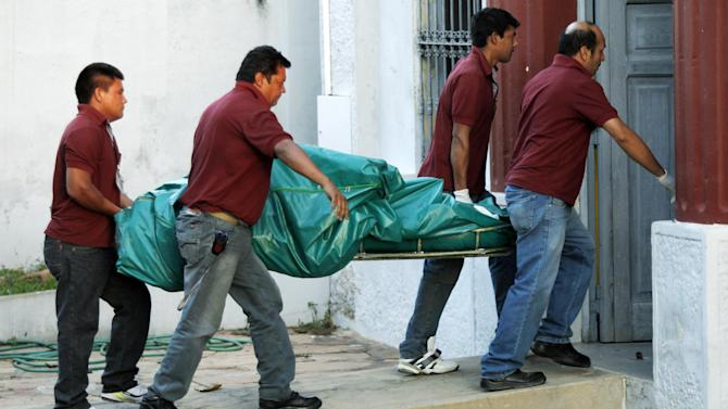 Employees of a funeral company carry the remains of the former Paraguayan presidential candidate Lino Cesar Oviedo, his bodyguard and a pilot to a morgue in Asuncion, Paraguay, Sunday, Feb. 3, 2013. Oviedo was returning with his bodyguard from a political rally in northern Paraguay Saturday night when his pilot encountered bad weather. All three were killed in the crash, said Johnny Villalba, a spokesman for Paraguay's airport authority. (AP Photo/Jorge Saenz)