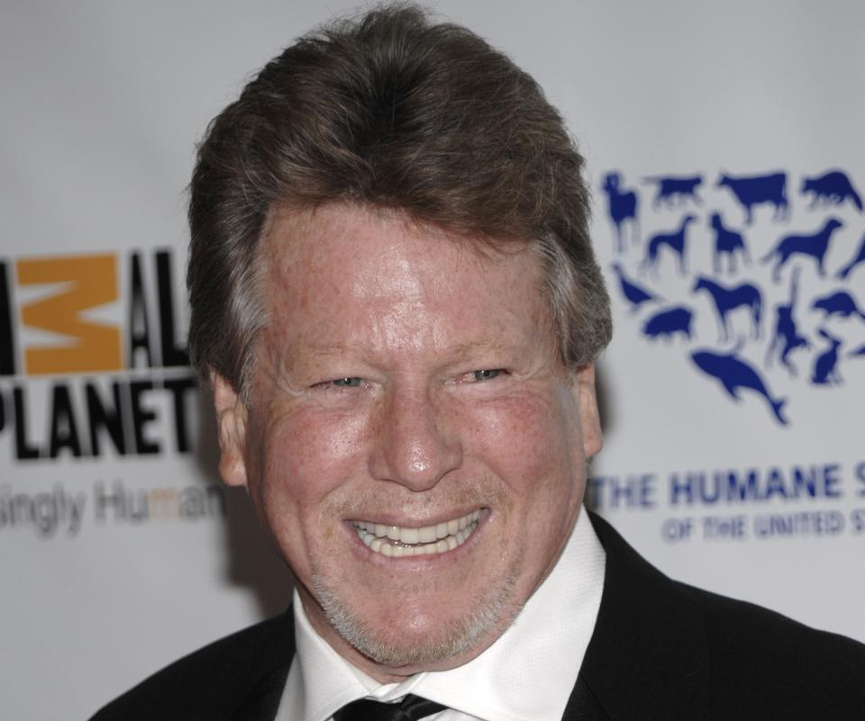 FILE - In this March 19, 2011 file photo, actor Ryan O'Neal arrives at The Genesis Awards benefiting the The Humane Society in Los Angeles. O'Neal has been diagnosed with Stage 2 prostate cancer. (AP Photo/Dan Steinberg, file)