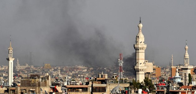In this citizen journalist image, smoke billows over Damascus, Syria, Wednesday, July 18, 2012. A bomb ripped through a high-level security meeting Wednesday in Damascus, killing three top regime officials  including President Bashar Assad&#39;s brother-in-law  in the harshest blow to Syria&#39;s ruling family dynasty and the rebels&#39; boldest attack in the country&#39;s civil war. Syrian state-run TV said the blast came during a meeting of Cabinet ministers and senior security officials in Damascus, which has seen four straight days of clashes between rebels and government troops. (AP Photo)