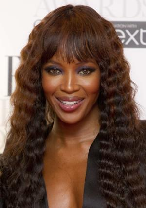FILE - In this Feb. 13, 2012 file photo, Naomi Campbell poses in the press room for the Elle Style Awards at the Savoy hotel in London. Campbell and a perfume company have settled a sour dispute that started over a fragrance line and became part of the backdrop of former Liberian President Charles Taylor's war crimes trial. Dueling lawsuits between the supermodel and an entity called Moodform Mission were closed Thursday, June 28, 2012, Manhattan court records show.  (AP Photo/Joel Ryan, File)