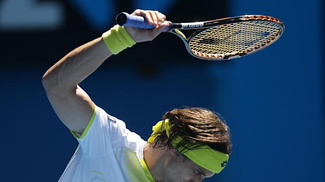 Spain's David Ferrer swings his racket in frustration during his quarterfinal match against compatriot Nicolas Almagro at the Australian Open tennis championship in Melbourne, Australia, Tuesday, Jan. 22, 2013. (AP Photo/Dita Alangkara)