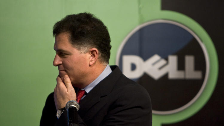 FILE - In this Thursday, March 26, 2009 file photo, Michael Dell, Chairman and CEO of Dell Inc., reacts to a question during a news conference in Beijing. Dell Inc. and Carl Icahn have agreed to cap his stake in the personal computer maker while a special board committee considers competing takeover bids from the billionaire investor, a group led by CEO Michael Dell and buyout specialist Blackstone Group. (AP Photo/Alexander F. Yuan, File)