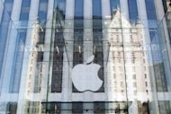 The Apple logo on the Apple store on 5th Avenue in New York. Apple shares traded above $700 for the first time on Wall Street Tuesday, amid optimism on the tech giant as it launches its new iPhone 5