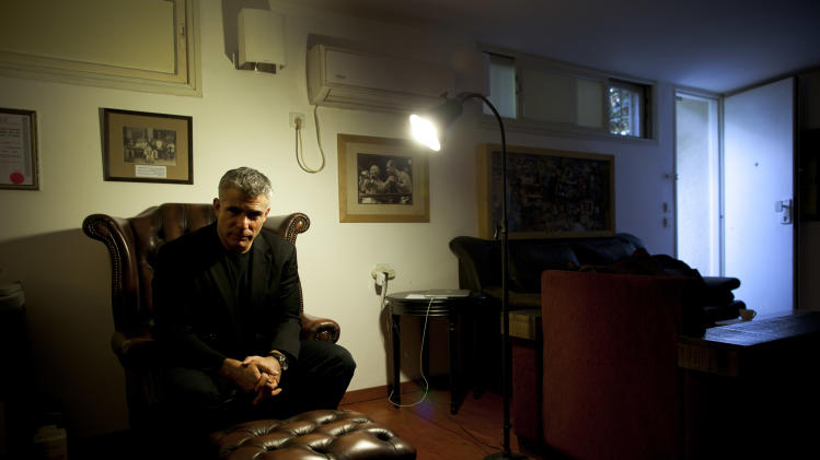 Yair Lapid, popular former TV anchorman and head of the new centrist party Yesh Atid, poses for a portrait at his house during an interview for the Associated Press in Tel Aviv, Israel, Wednesday, June. 16, 2013. Lapid predicted he will one day become prime minister and said he would fight for a more moderate policy towards the Palestinians. (AP Photo/Oded Balilty)