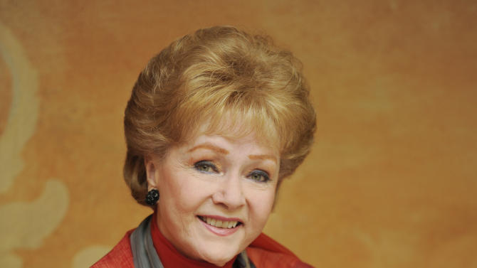 "In this Tuesday, May 21, 2013 photo, Debbie Reynolds, a cast member in the film ""Behind the Candelabra,"" poses for a portrait in Beverly Hills, Calif. Reynolds plays Frances, the mother of the pianist and vocalist, Liberace. HBO debuts ""Behind the Candelabra"" in the US, Sunday, May 26, 2013. (Photo by Chris Pizzello/Invision/AP)"