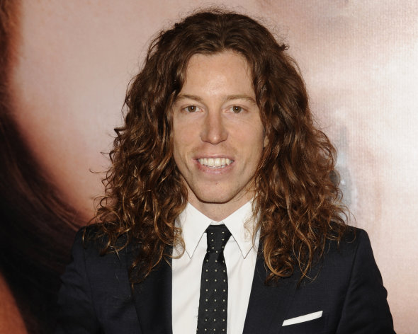 FILE - In this file photo taken April 18, 2012, Olympic athlete Shaun White is photographed in New York. A Nashville, Tenn., police report says the two-time Olympic gold medalist snowboarder was charged with vandalism after an employee at a Nashville hotel saw him break a phone there. He is charged with vandalism of $500 or less. (AP Photo/Evan Agostini, File)