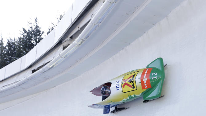 USA's pilot Elana Meyers with brakewoman Tianna Madison race to a third-place finish in the women's bobsled World Cup competition on Friday, Nov. 9, 2012, in Lake Placid, N.Y. (AP Photo/Mike Groll)