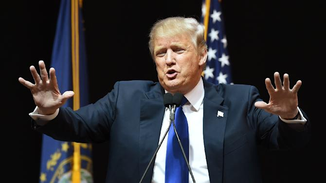 Republican presidential hopeful Donald Trump speaks to the crowd during a rally on February 8, 2016 in Manchester, New Hampshire