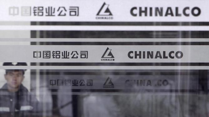 File photo of a security guard standing in position in the headquarters of Chinalco in Beijing