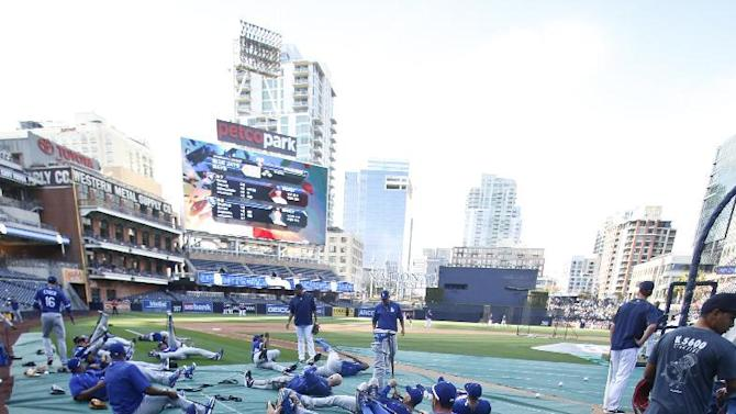 Los Angeles Dodgers players do their pregame exercises prior to a baseball game against the San Diego Padres Friday, April 24, 2015 in San Diego.   (AP Photo/Lenny Ignelzi)