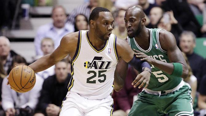 Boston Celtics' Kevin Garnett (5) guards Utah Jazz's Al Jefferson (25) in the first quarter during an NBA basketball game, Monday, Feb. 25, 2013, in Salt Lake City. (AP Photo/Rick Bowmer)