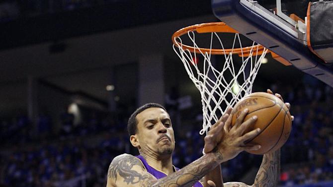 Los Angeles Lakers forward Matt Barnes (9) grabs a rebound between Oklahoma City Thunder center Nazr Mohammed, left, and guard Russell Westbrook, right, in the second quarter of Game 1 in the second round of the NBA basketball playoffs, in Oklahoma City, Monday, May 14, 2012. (AP Photo/Sue Ogrocki)
