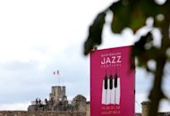 A picture taken on July 19 in Saint Emilion, western France shows an official poster for the Saint-Emilion Jazz festival. The organiser of the event, one of half a dozen packing the summer schedule in and around southwestern Bordeaux, turned to the festival scene after retiring from a career as a wine merchant