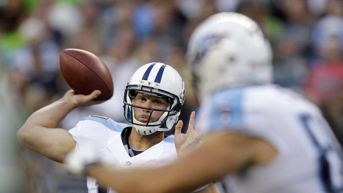 Tennessee Titans quarterback Jake Locker passes the ball to tight end Craig Stevens, right, in the first half of an NFL football preseason game against the Seattle Seahawks, Saturday, Aug. 11, 2012, in Seattle. (AP Photo/Stephen Brashear)