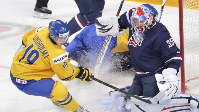 Team USA goaltender John Gibson makes a save off Sweden's Elias Lindholm during first period gold medal hockey action at the IIHF World Junior Championships in Ufa, Russia, on Saturday, Jan. 5, 2013. (AP Photo/The Canadian Press, Nathan Denette)