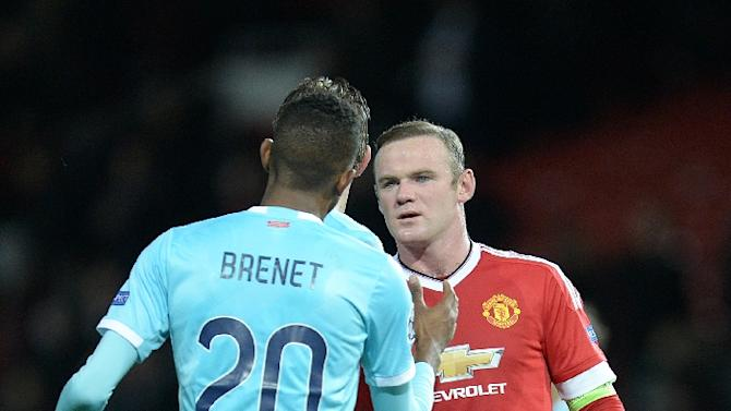 Manchester United's striker Wayne Rooney (R) speaks with PSV Eindhoven's defender Joshua Brenet after a 0-0 draw in a UEFA Champions League Group match at Old Trafford Stadium on November 25, 2015